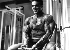 John Terilli Professional Mr. Universe winner doing bicep curls fully pumped